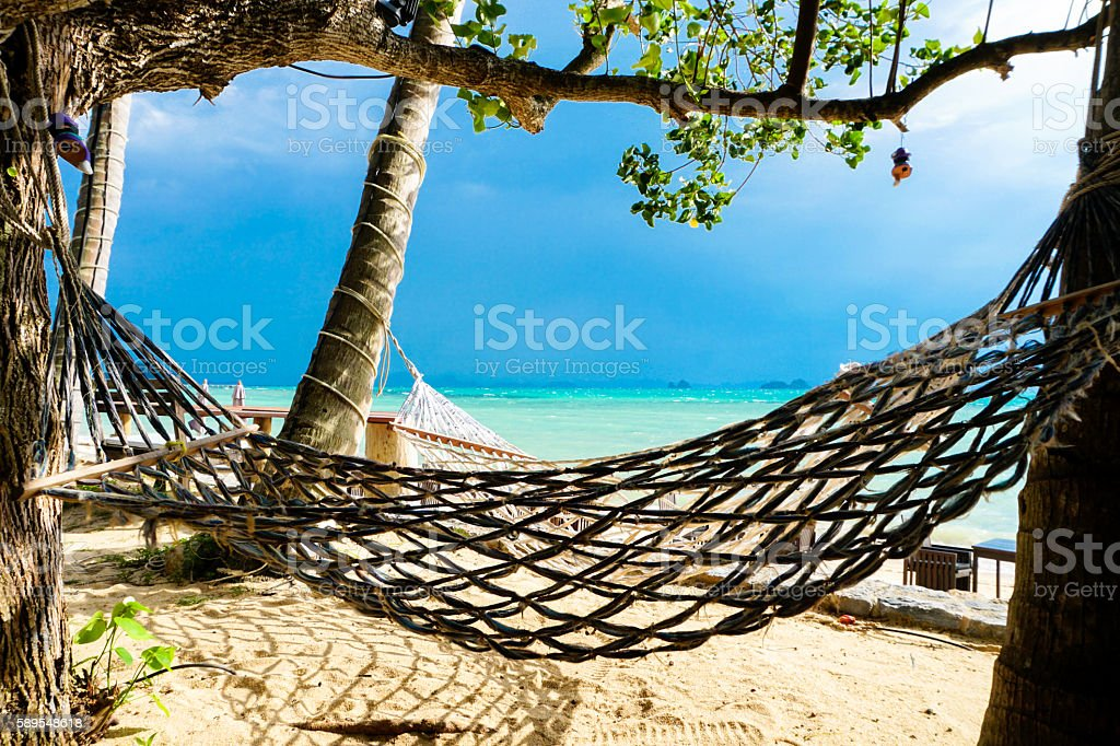Hammock on the beach in stormy weather stock photo