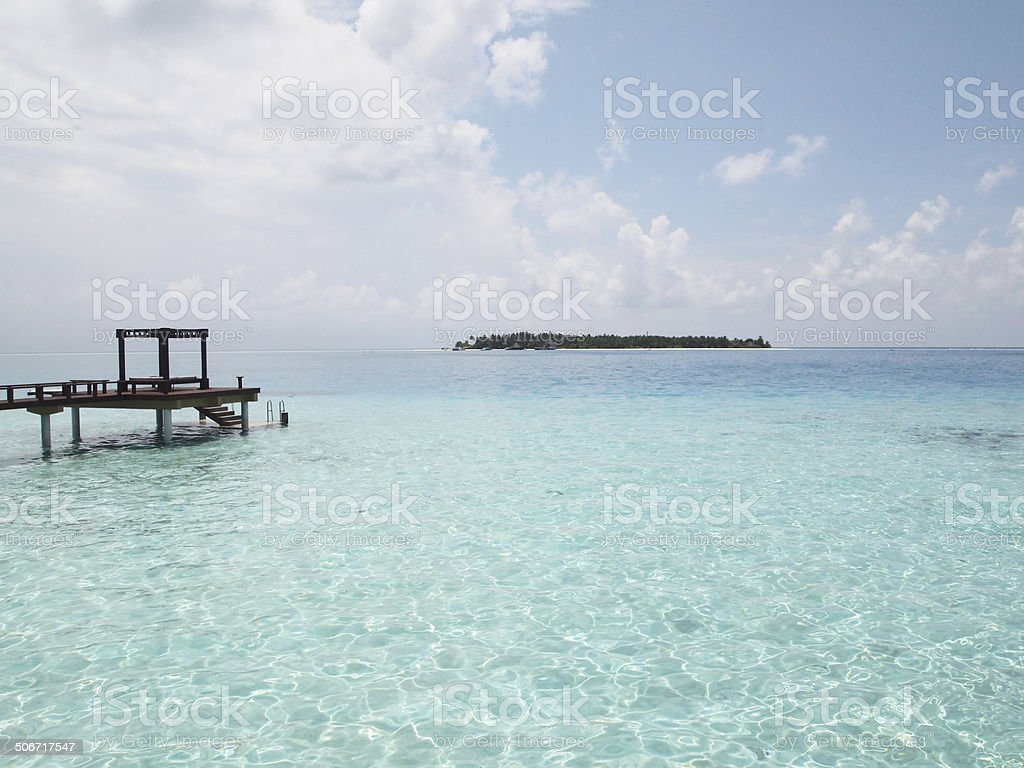 Hammock on the crystal clear water in Maldives stock photo
