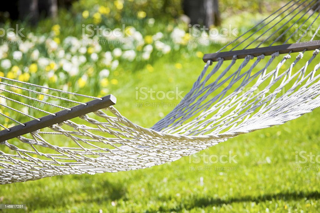 Hammock out on sunny yard near flower garden royalty-free stock photo