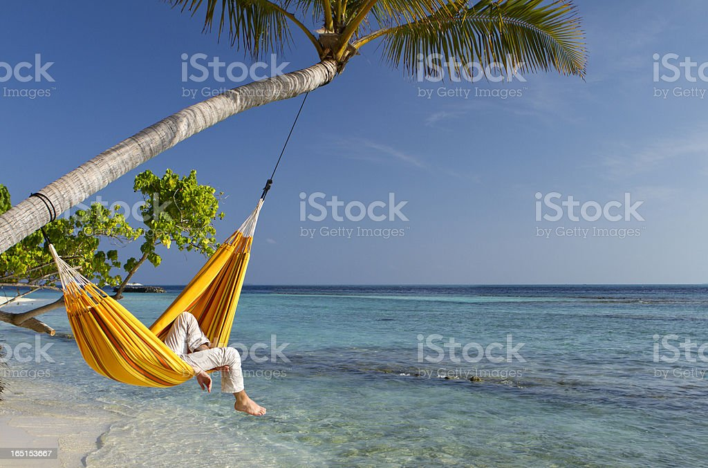 Hammock relaxation by the sea stock photo