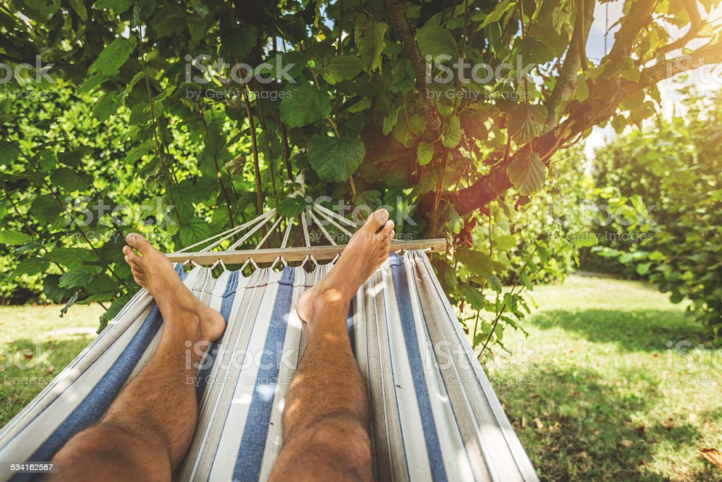 Hammock relaxing point of view stock photo