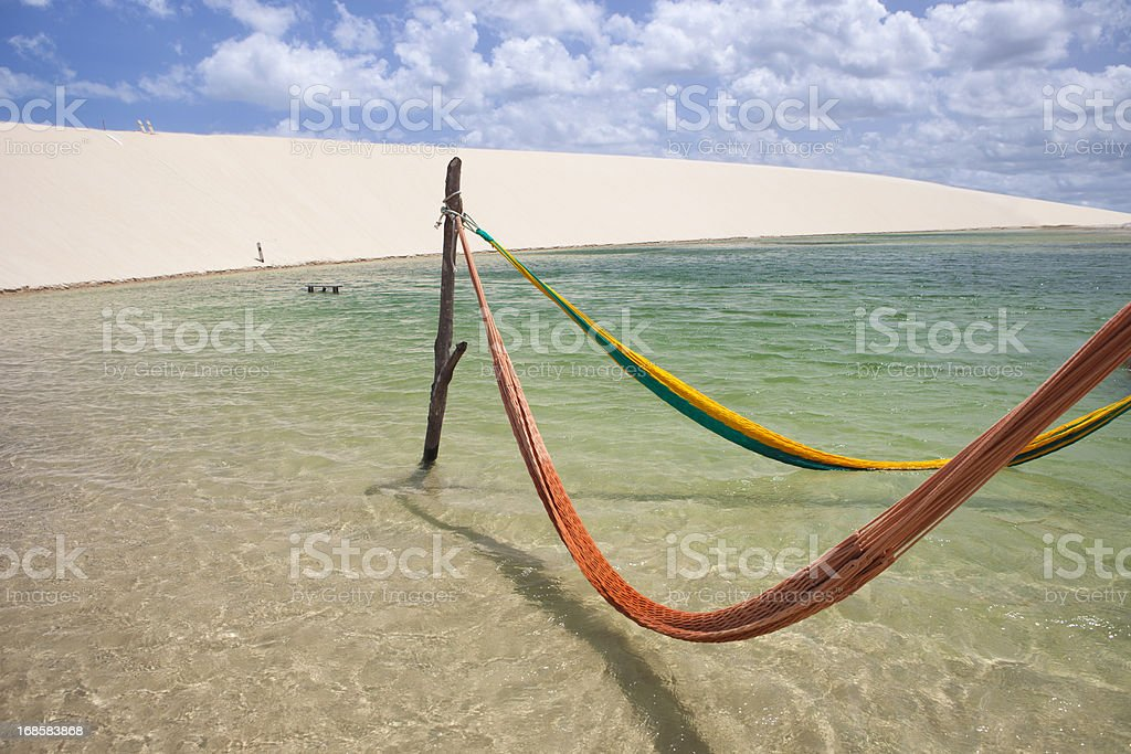 Hammocks in Lagoon, Jericoacoara, Brazil stock photo