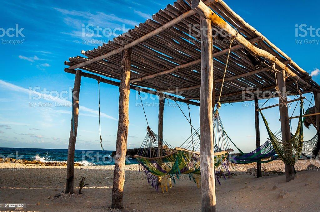 Hammocks on the idyllic beach on Cozumel island Yucatan Mexico stock photo