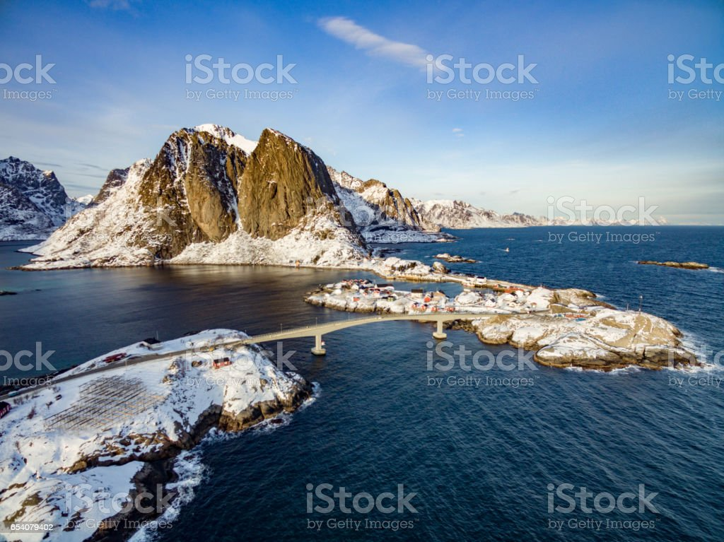Hamnoy from above, Lofoten islands, Norway. Red Rorbu and Olstind Mount stock photo