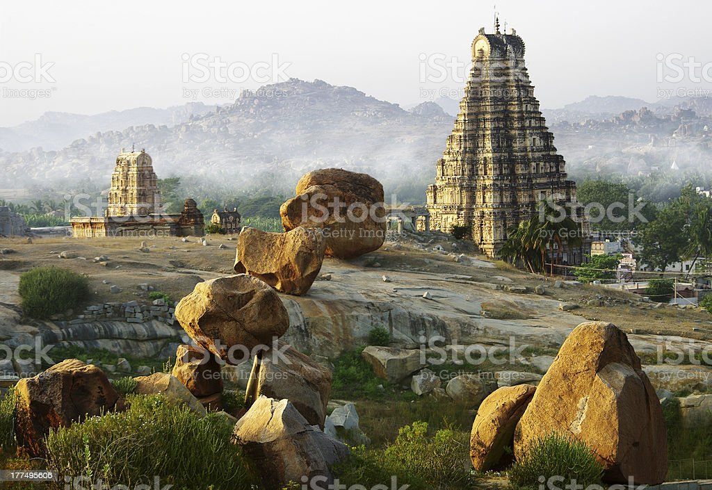 Hampi with foggy mountains in background royalty-free stock photo