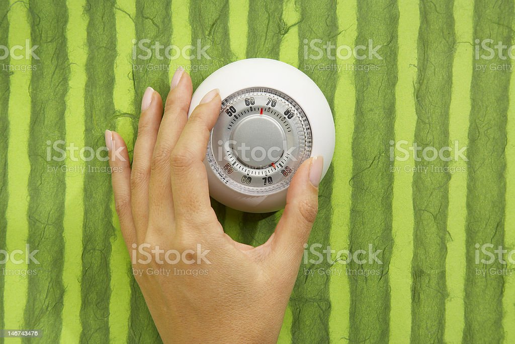 Hand Adjusting Thermostat stock photo