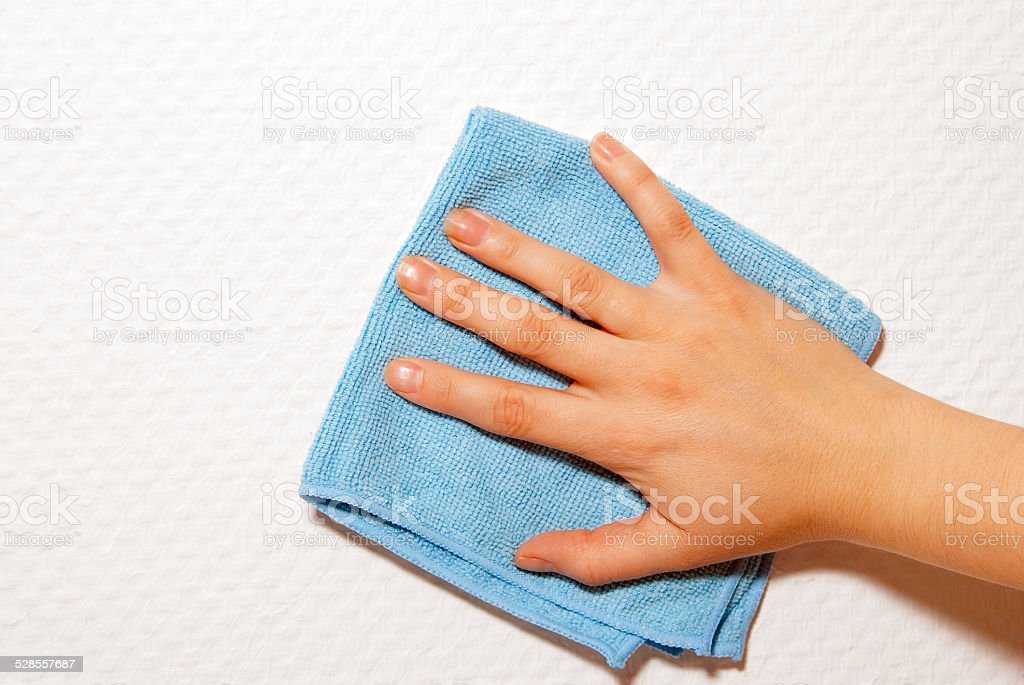 hand and a blue cloth royalty-free stock photo