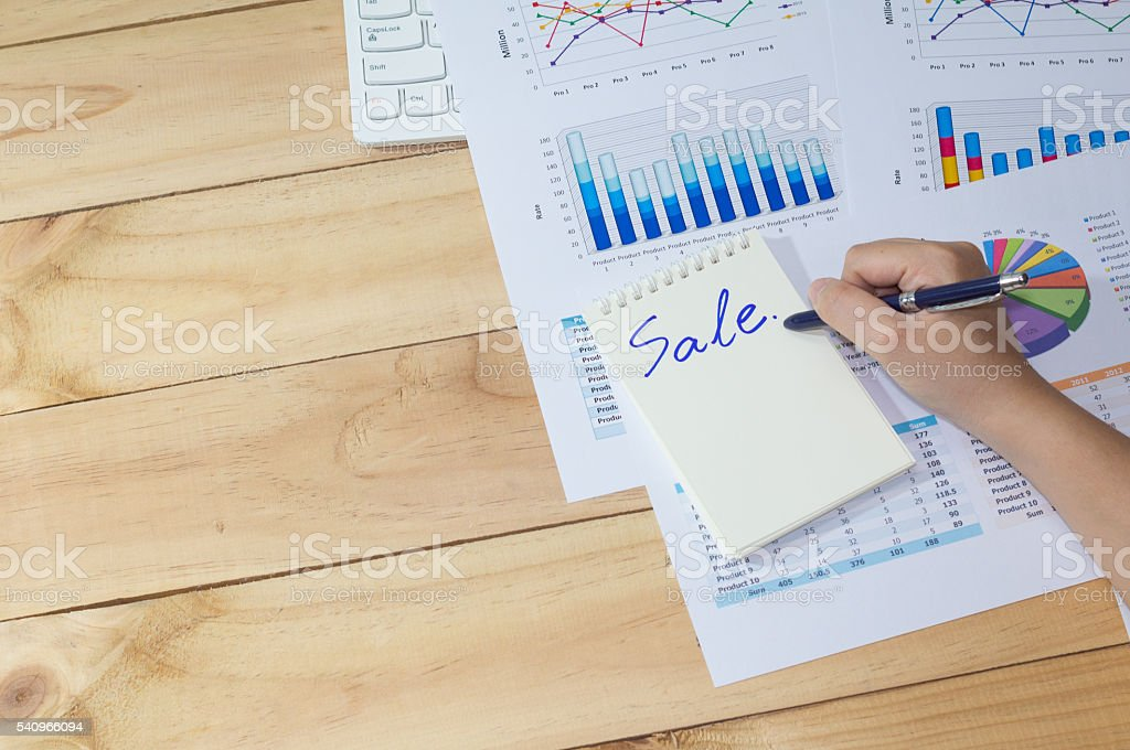 hand and arm business man point analysis financial paper Стоковые фото Стоковая фотография