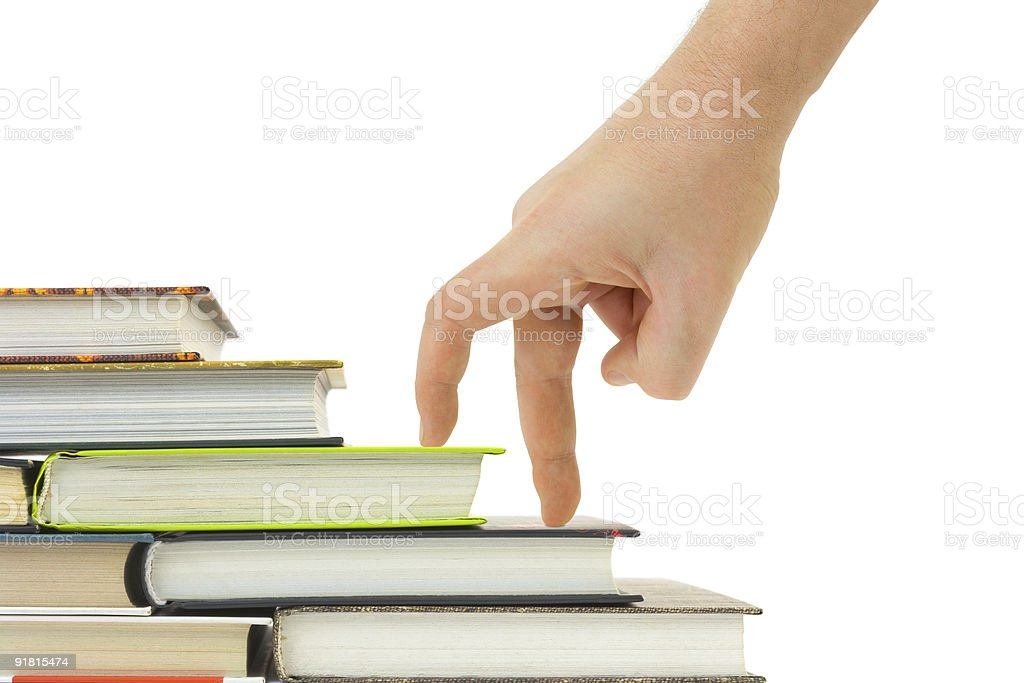 Hand and book stairs royalty-free stock photo