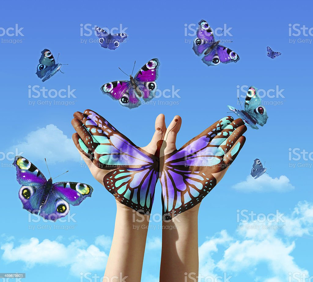 Hand and butterflys stock photo