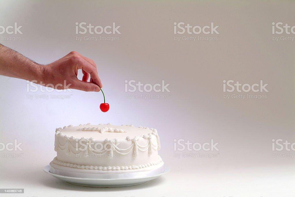 hand and cherry stock photo
