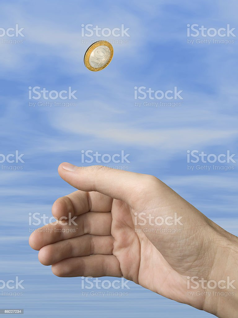 Hand and coin (choice) royalty-free stock photo