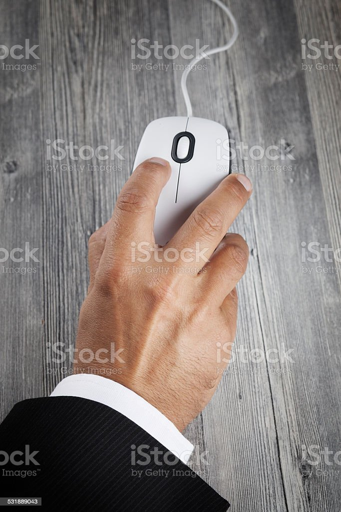 Hand and computer mouse stock photo