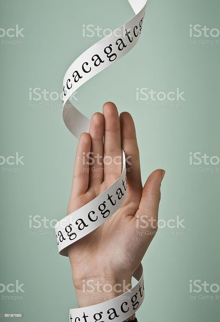 Hand and DNA ribbon stock photo