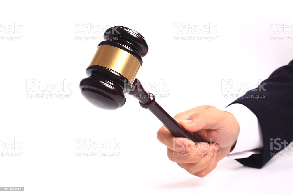 Hand and gavel stock photo