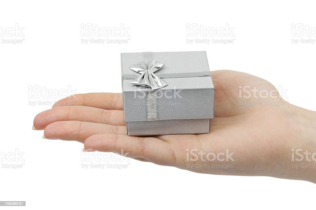 Hand and gift royalty-free stock photo