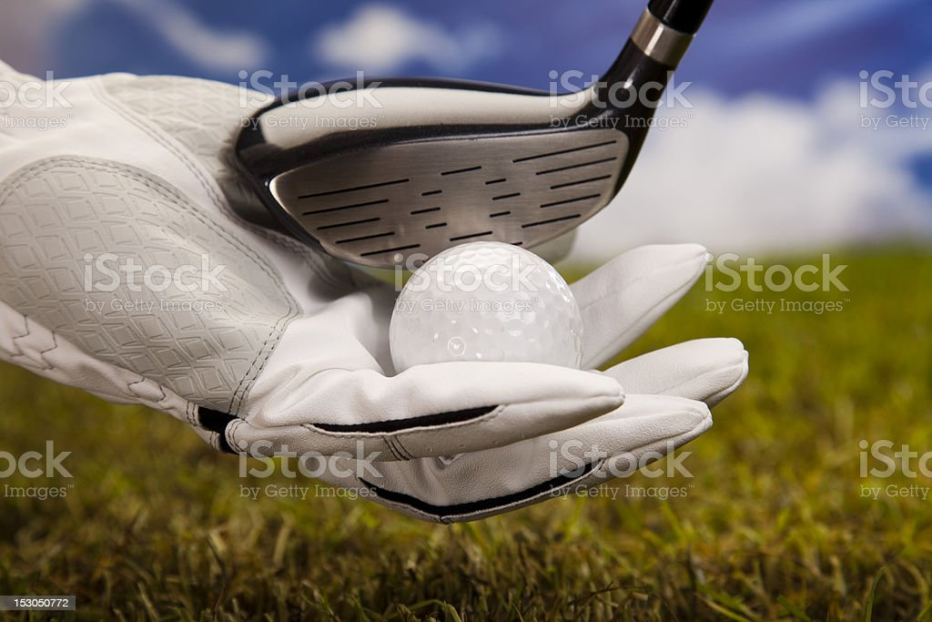 Hand and golf ball royalty-free stock photo
