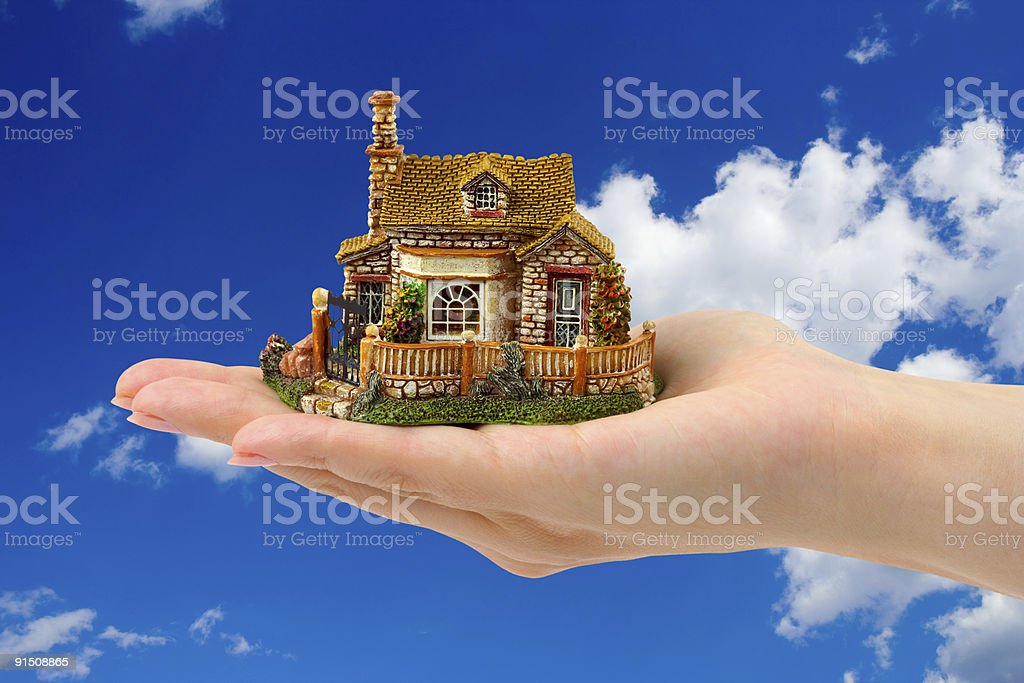 Hand and house royalty-free stock photo
