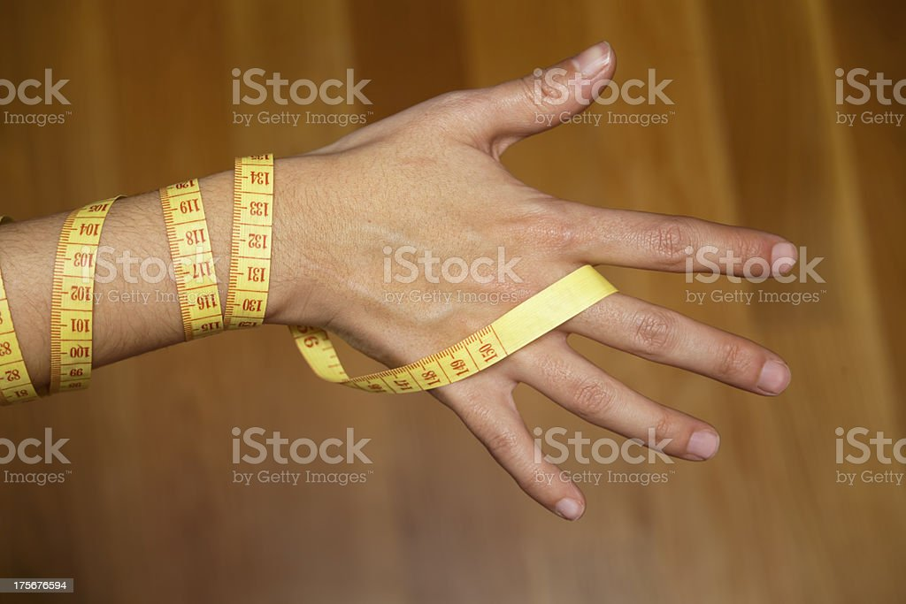 Hand and measuring tape. stock photo