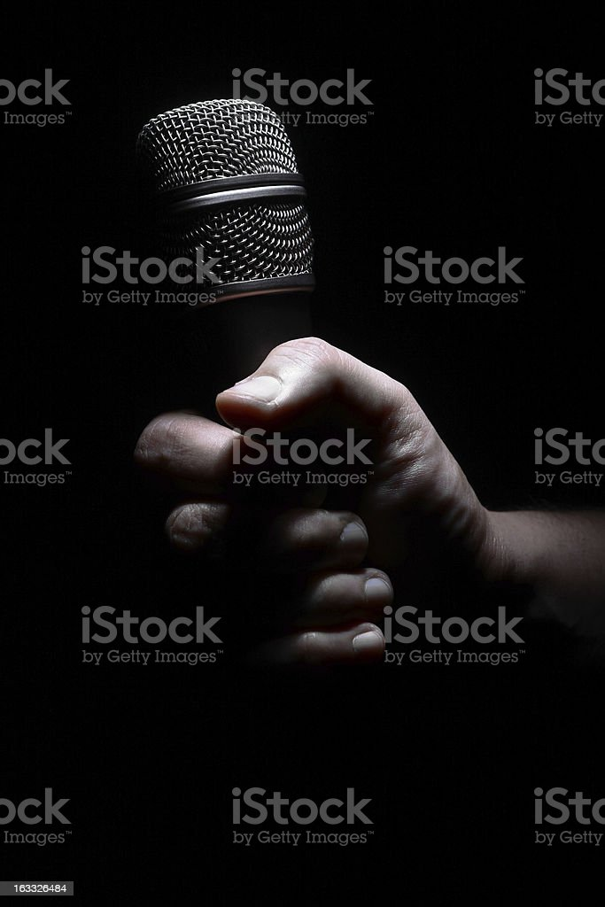 Hand and microphone royalty-free stock photo
