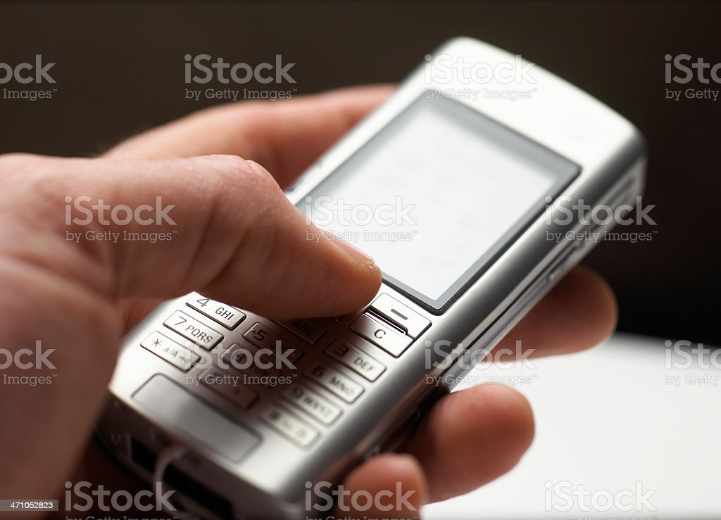 hand and mobile phone royalty-free stock photo