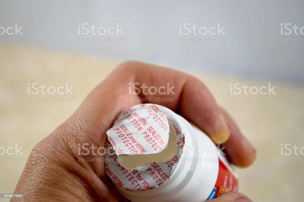 Hand and opened pill bottle stock photo