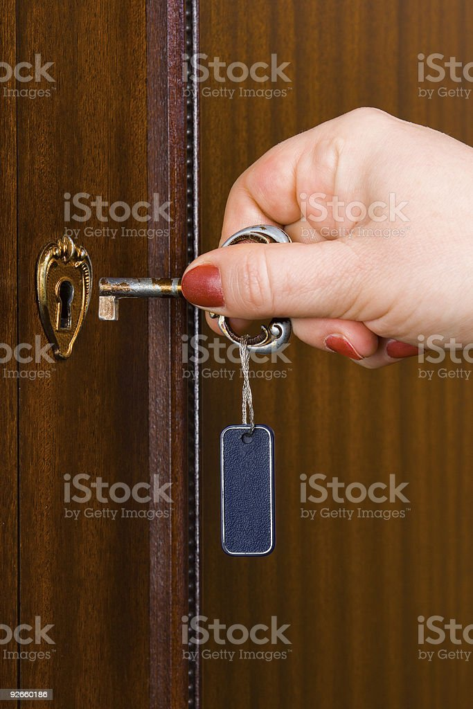 Hand and retro key with label royalty-free stock photo