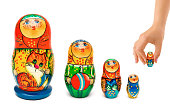 Hand and russian toy matrioshka