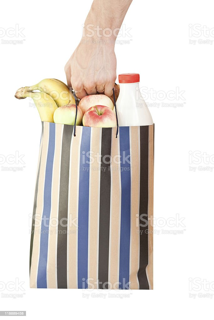 hand and shopping bag with food royalty-free stock photo