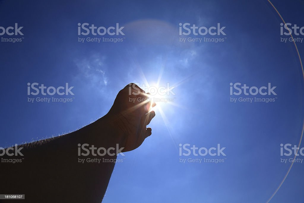 Hand and sun stock photo