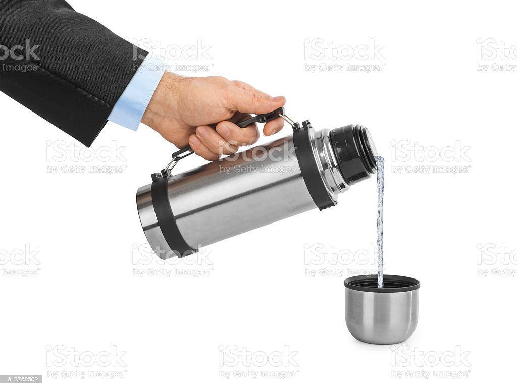 Hand and thermos flask stock photo
