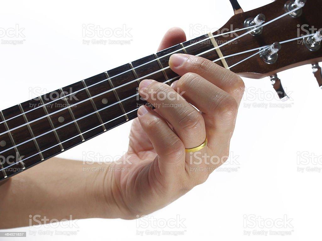 hand and ukulele stock photo