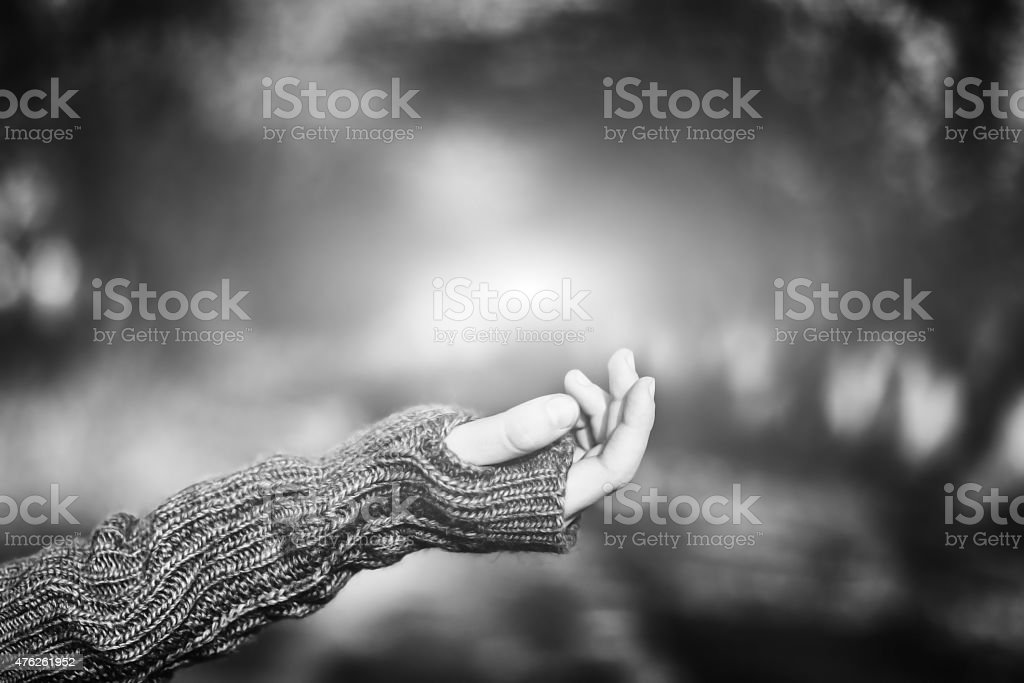 Hand asking for alms stock photo
