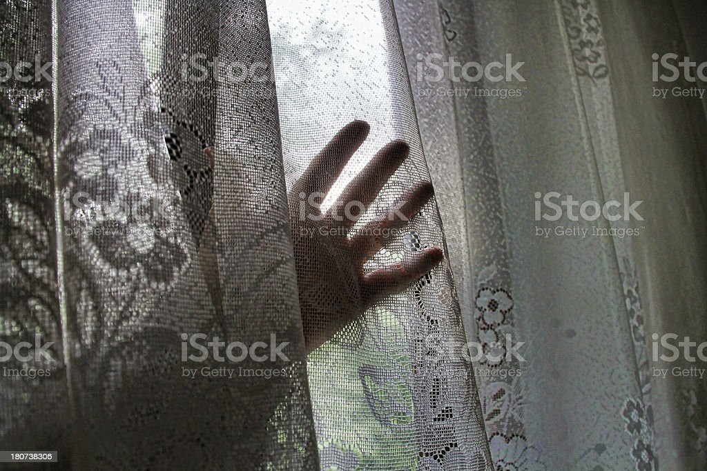 hand behind the curtain royalty-free stock photo