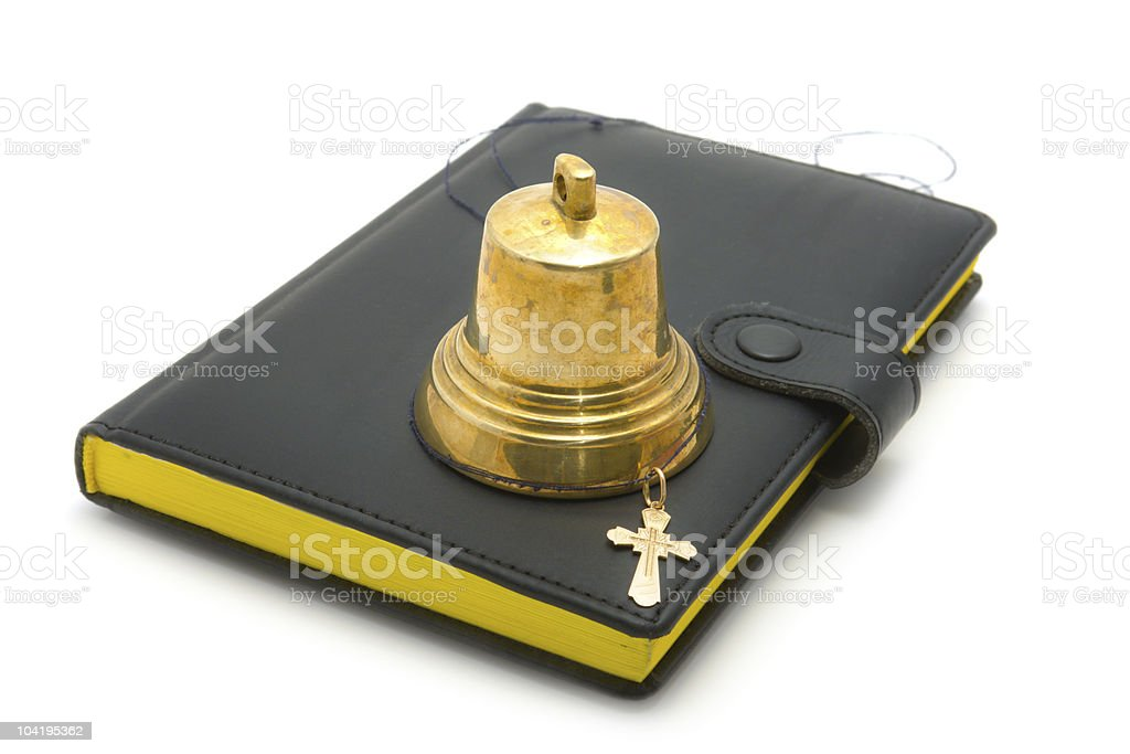 Hand bell, dagger and the bible royalty-free stock photo