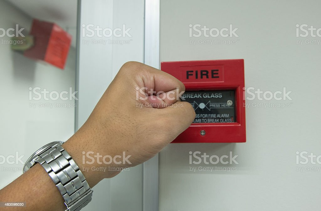 hand brake the fire alarm for at the wall. stock photo