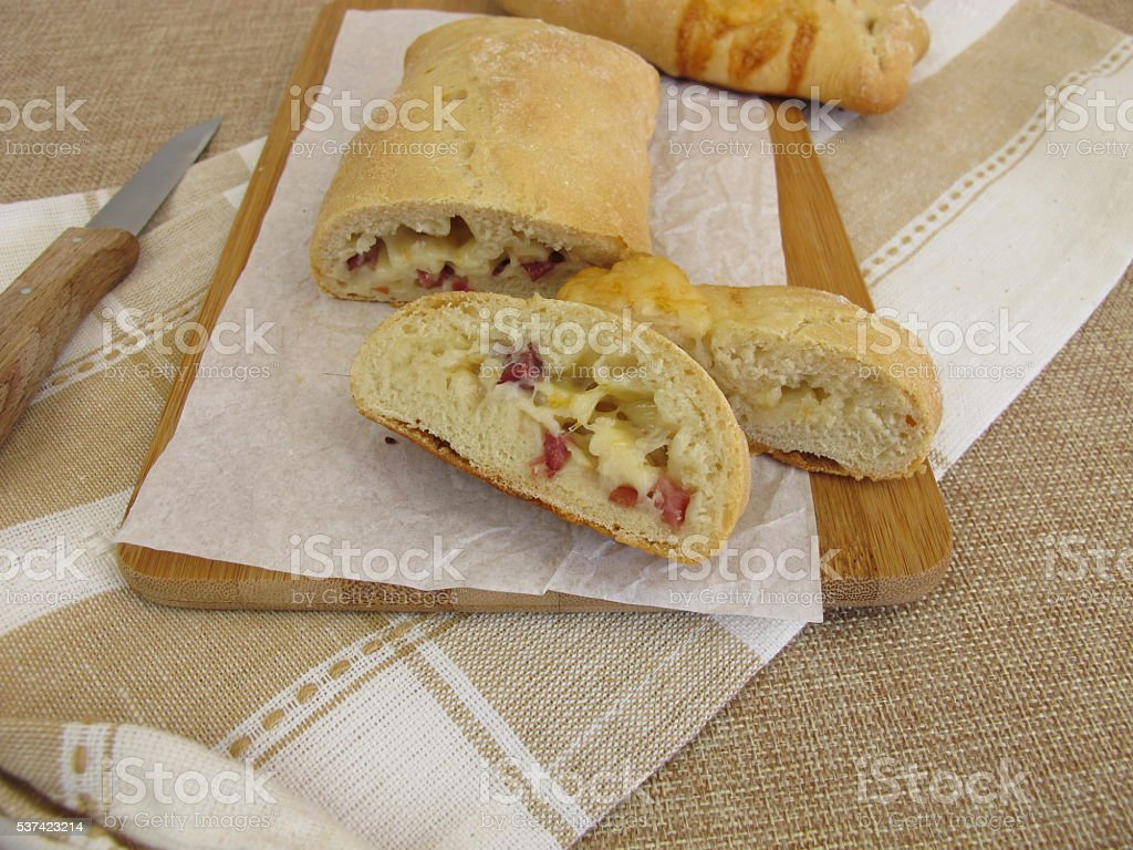 Hand bread filled with cheese and ham stock photo
