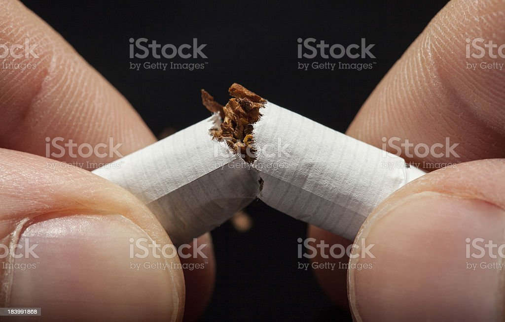 Hand Breaking Cigarette royalty-free stock photo