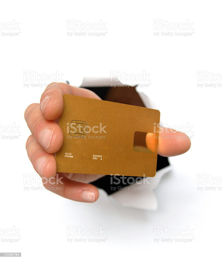 Hand Bursting From White Background Holding Credit Card royalty-free stock photo
