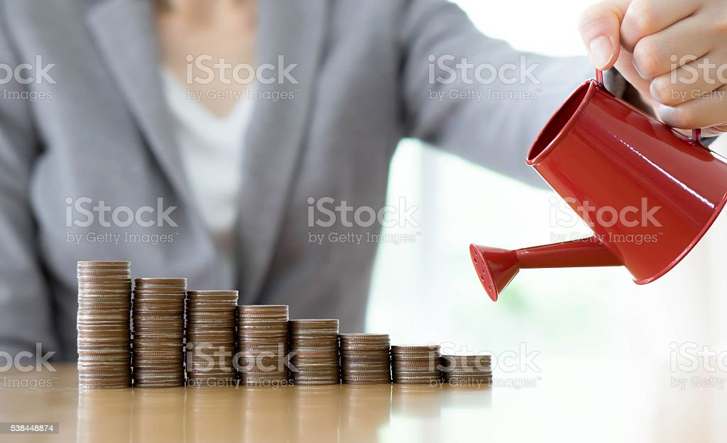 hand business woman and red watering can with money stock photo