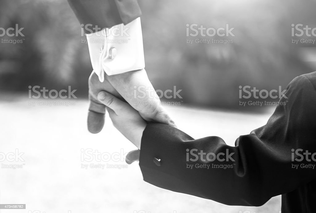 Hand by hand stock photo