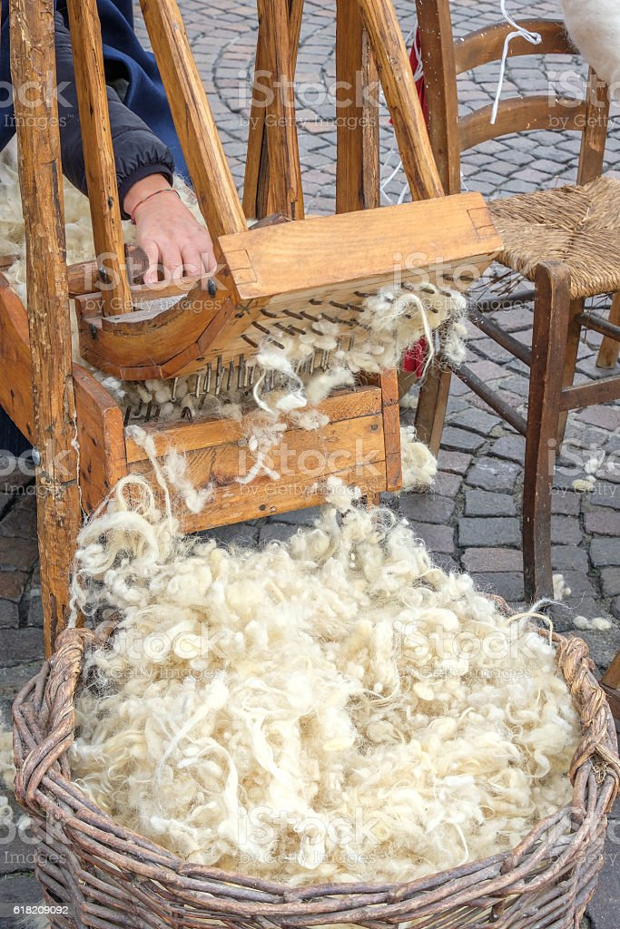 hand carder wood carding cotton stock photo