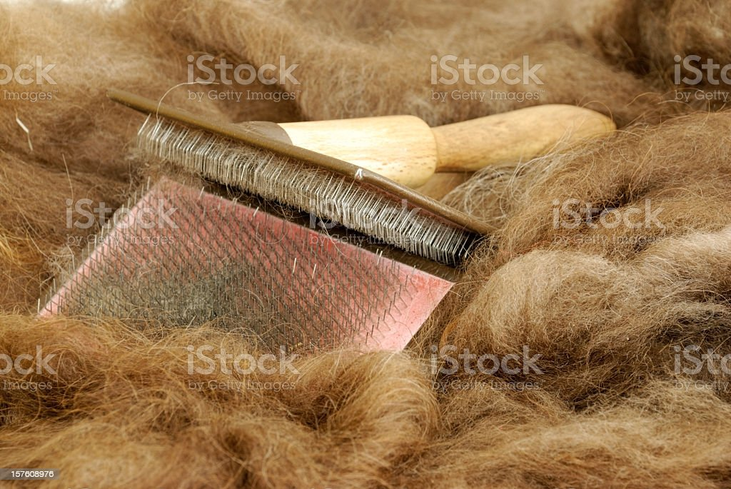 Hand carding tool and wool stock photo