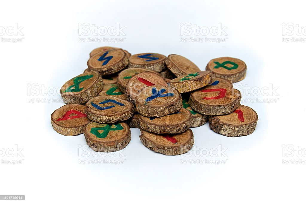hand carved and painted germanic wooden oak runes stock photo