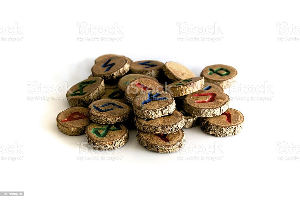 hand carved and painted wooden oak runes on white stock photo