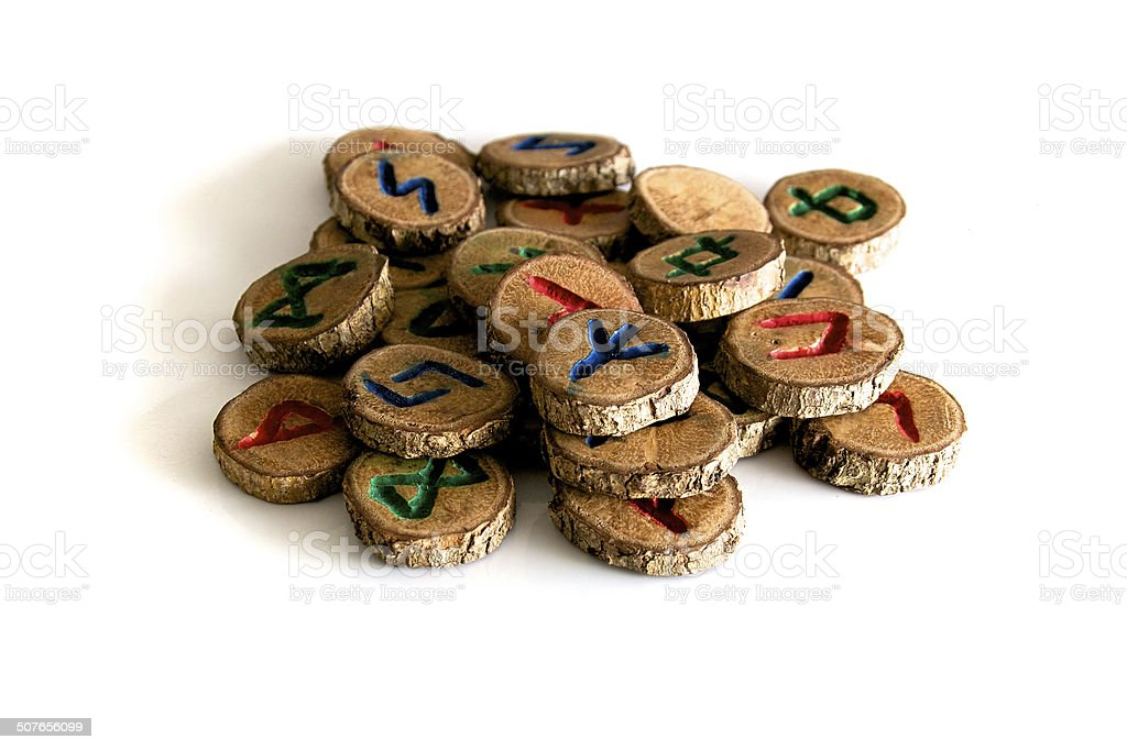 hand carved and painted wooden oak runes stock photo