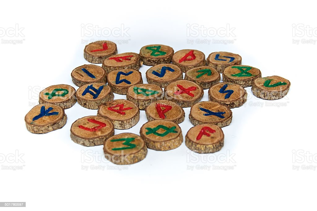 hand carved and painted wooden runes stock photo