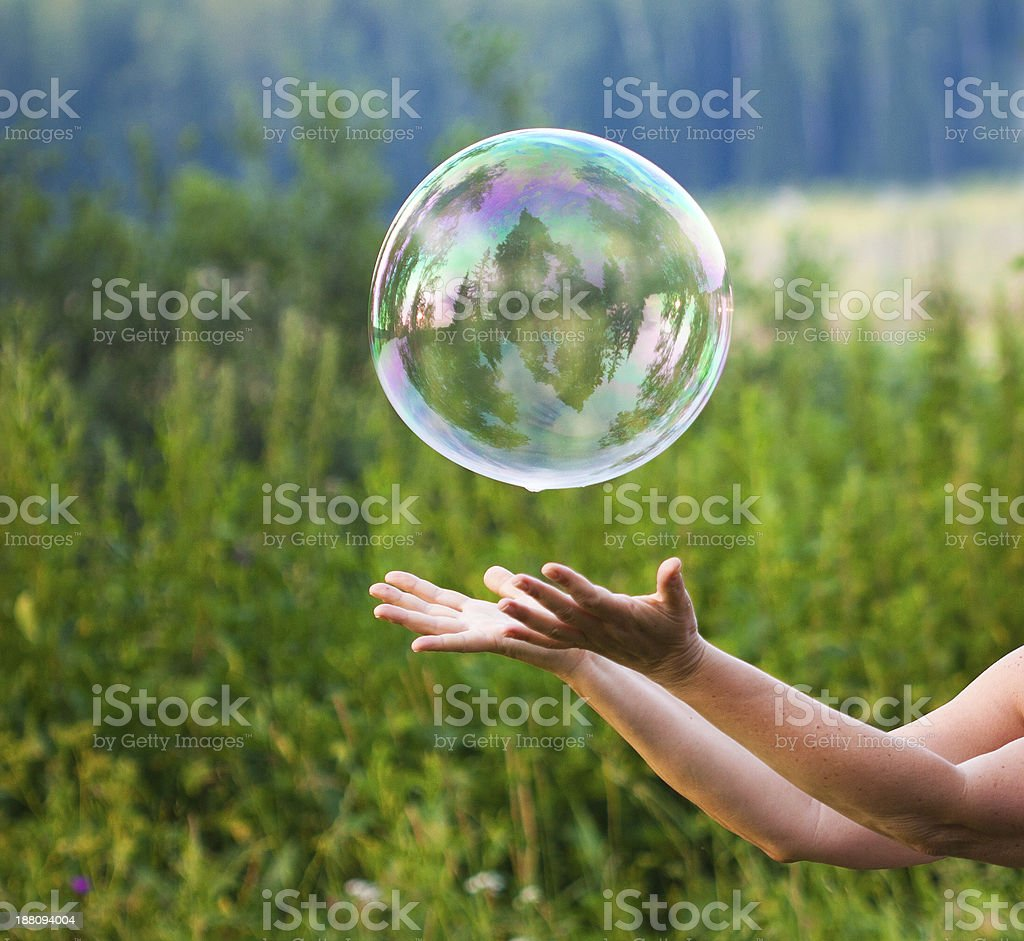 hand catching a soap bubble stock photo