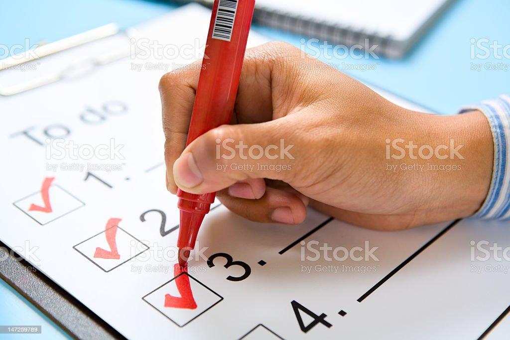 Hand check mark the list stock photo