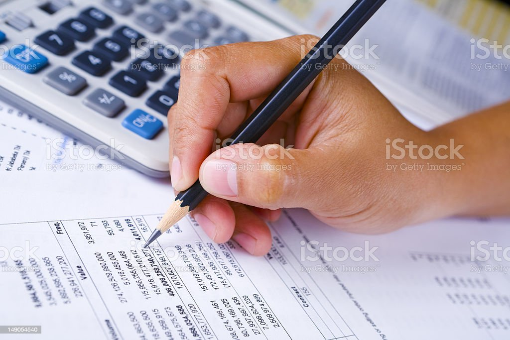 Hand checking financial report stock photo